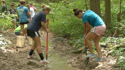 Nichole Barnard and Olivia Cabanban work in Holliday Park as part of BITS.