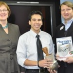 Andrew Gonzales, center, receives his RESPy Award from Wal-Mart representative Wayne Mitchell. College of Pharmacy and Health Sciences Dean Mary Graham is at left.