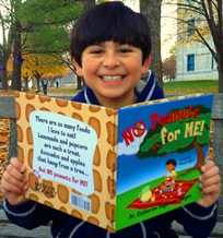 Hudson Pang with the book he inspired, NO Peanuts for ME!