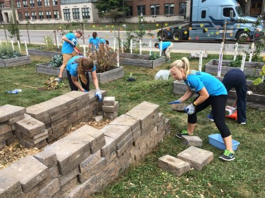 Seniors Sam Marulli and Claire Thoma laid the bricks for a compost pile at the Butler lab school.