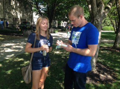 Kelsey Timmerman signs his book for first-year student Kimi Selgrad.