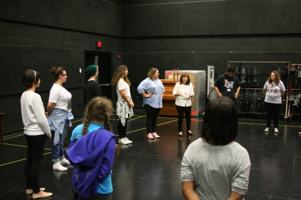 Theatre Professor Elaina Artimiev (white jacket) leads a group at Theatre Day.