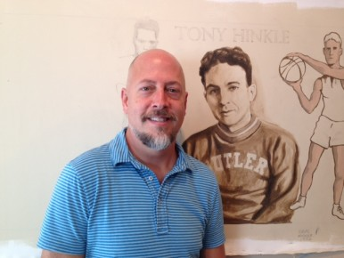 Artist Jon Edwards, and his drawing of Tony Hinkle.