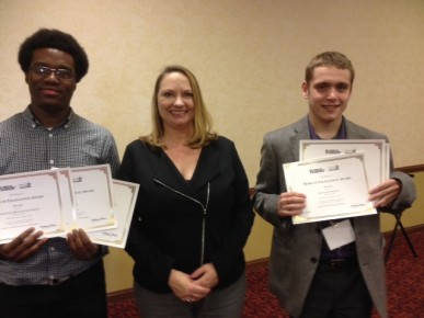 Award-winning Butler Collegian editor in chief Julian Wyllie, left, and managing editor Matthew VanTryon, right, with national SPJ President Dana Neuts at the SPJ Region 5 Conference in Louisville on Saturday.