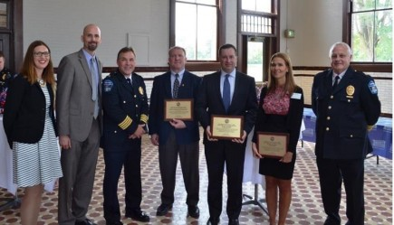 Butler University was presented with the Crime Fighter of the Year Award at the 32nd annual National Night Out Kick-Off Ceremony on August 4. Pictured, from left, are Assistant Prosecutor Kristen Martin, Deputy Prosecutor Ryan Mears, Butler Assistant Police Chief Andy Ryan, Detective Bruce Allee, University Chief of Staff and Executive Director of Public Safety Ben Hunter, Assistant Professor Brandie Oliver, and Butler Assistant Police Chief John Conley.