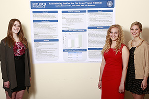 From left, Beth McGlone, Karina Hamamouche, and Emily Lauth with their poster for the Association for Psychological Science convention.