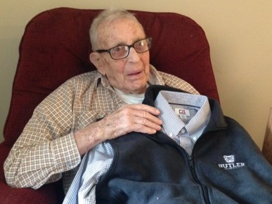 Sam Arnett shows off one of his birthday gifts, a shirt and vest from Butler.