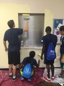 A group of volunteers paint the walls in the MLK Community Center.