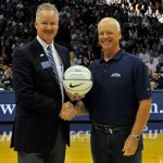 John Dunn, right, receives a Hinkle Campaign branded ball from Barry Collier.
