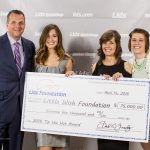 Senior Liz Niemiec (second from left) receives her second award from the LIDS Foundation.