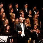 Eric Stark conducting Butler's annual Rejoice! concerts, which this year will take place on December 9 and 10 in Clowes Memorial Hall.